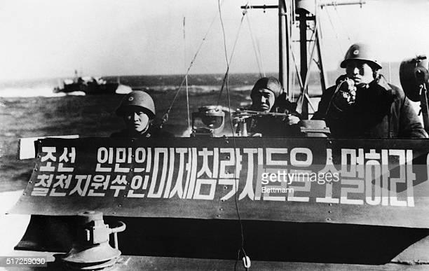 Shown in this undated file photo is a North Korean patrol boat bearing a message which is said to read 'Destroy the American invaders the enemy of...