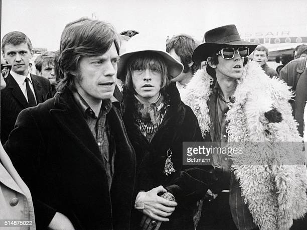 Shown on their arrival in Zurich April 14th are three of the five members of the Rolling Stones Mick Jagger Brian Jones and Keith Richards