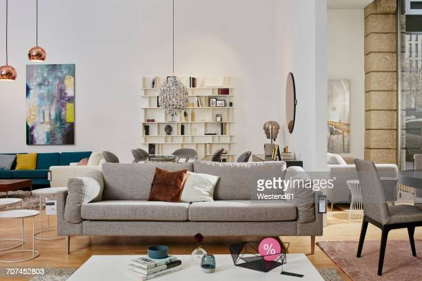 showroom interior of a furniture shop with percent sign on coffee table - sofa stock pictures, royalty-free photos & images