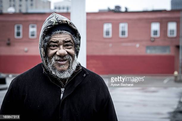 Shows a homeless man, who rather than stay negative with his bad fortune, still manages to keep a smile on his face.