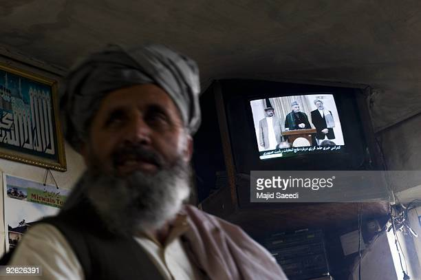 Shows Afghan President Hamid Karzai attending a press conference at the Presidential Palace on November 3, 2009 in Kabul, Afghanistan. Re-elected...