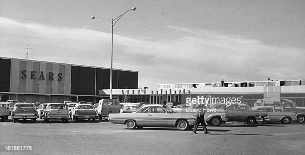 FEB 28 1963 MAR 6 1963 Shows an exterior view of the new mall which connects the MayDF department store with the new Sears Roebuck Co store which...