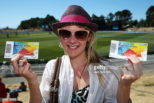 A shows off her tickets during the 2015 ICC Cricket World Cup match between Zimbabwe and the United Arab Emirates at Saxton Field on February 19 2015...