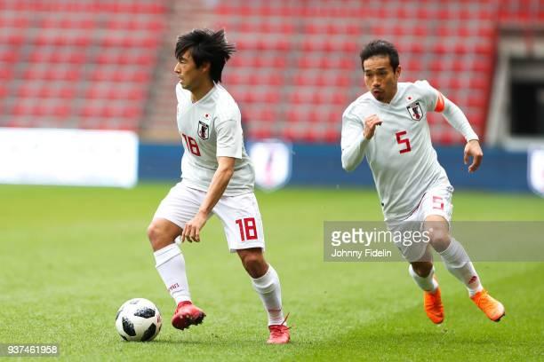 Shoya Nakajima and Yuto Nagatomo of Japan during the International friendly match between Japan and Mali on March 23 2018 in Liege Belgium