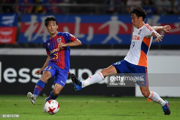 Shoya Nakajima of FC Tokyo and Kisho Yano of Albirex Niigata compete for the ball during the JLeague J1 match between FC Tokyo and Albirex Niigata at...