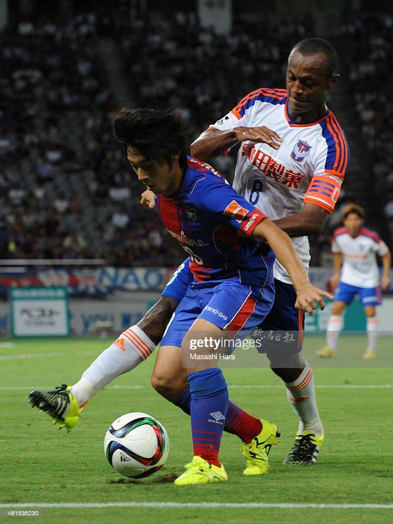 Shoya Nakajima of FC Tokyo and Leo Silva of Albirex Niigata compete for the ball during the J.League match between FC Tokyo and Albirex Niigata at Ajinomoto Stadium on July 15, 2015 in Chofu, Tokyo, Japan.