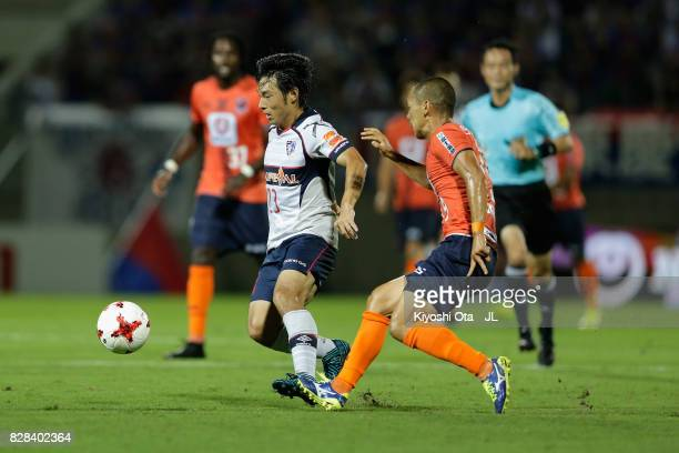 Shoya Nakajima of FC Tokyo and Ryo Okui of Omiya Ardija during the J.League J1 match between Omiya Ardija and FC Tokyo at NACK 5 Stadium Omiya on...