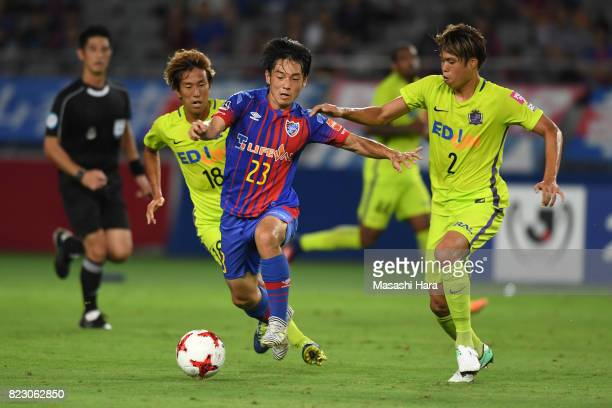 Shoya Nakajima of FC Tokyo and Yuki Nogami of Sanfrecce Hiroshima compete for the ball during the JLeague Levain Cup PlayOff Stage first leg match...