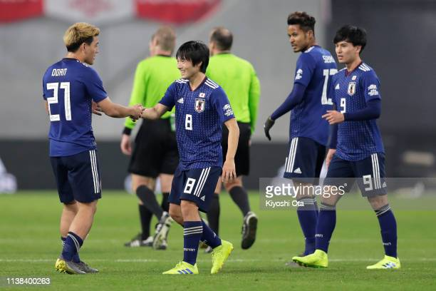 Shoya Nakajima of Japan and Ritsu Doan of Japan celebrate the team's 10 victory in the international friendly match between Japan and Bolivia at...