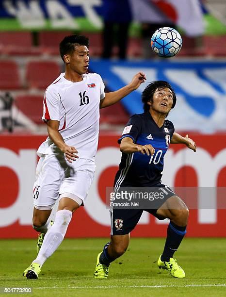 Shoya Nakajima of Japan battles for the ball with Pak Myong Song of North Korea during the AFC U23 Championship Group B match between Japan and North...