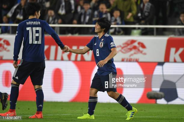 Shoya Nakajima of Japan celebrates his opener with his team mate Daichi Kamada of Japan during the international friendly match between Japan and...