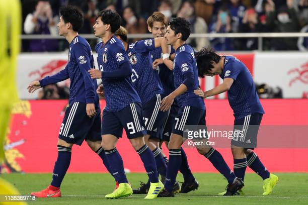 Shoya Nakajima of Japan celebrates scoring the opening goal with his teammates during the international friendly match between Japan and Bolivia at...