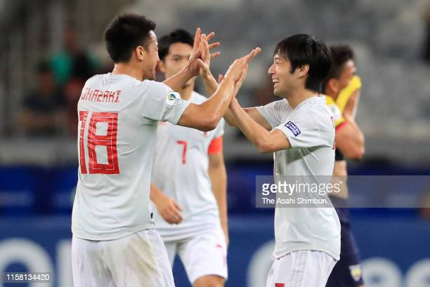 Shoya Nakajima of Japan celebrates scoring the opening goal with his team mate Shinji Okazaki during the Copa America Brazil 2019 group C match...