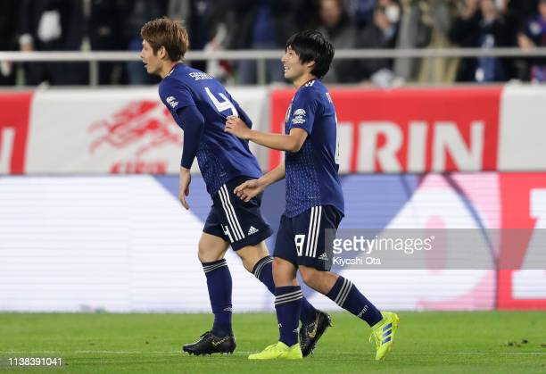 Shoya Nakajima of Japan celebrates scoring the opening goal with Sho Sasaki of Japan during the international friendly match between Japan and...