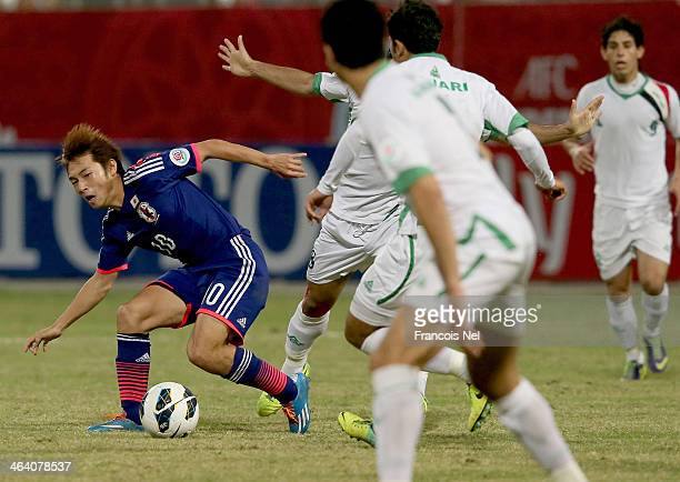Shoya Nakajima of Japan controls the ball during the AFC U22 Championship quarter final match between Iraq and Japan at Seeb Sports Complex on...