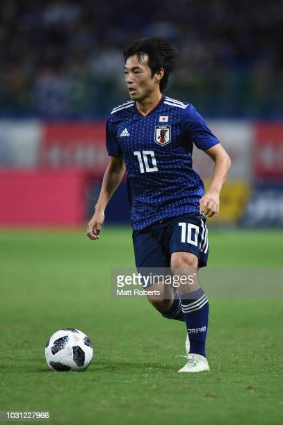 Shoya Nakajima of Japan controls the ball during the international friendly match between Japan and Costa Rica at Suita City Football Stadium on...