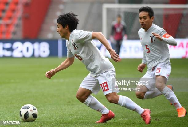 Shoya Nakajima of Japan dribbles the ball while Yuto Nagatomo of Japan watching during the International friendly match between Japan and Mali at the...