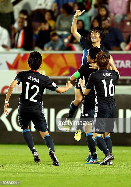 Shoya Nakajima of Japan is congratulated after scoring Japans third goal in extra time during the AFC U-23 Championship quarter final match between...