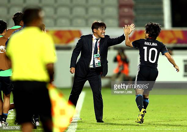 Shoya Nakajima of Japan is congraulated by Makoto Teguramori Head Coach of Japan after scoring a goal in extra time during the AFC U23 Championship...