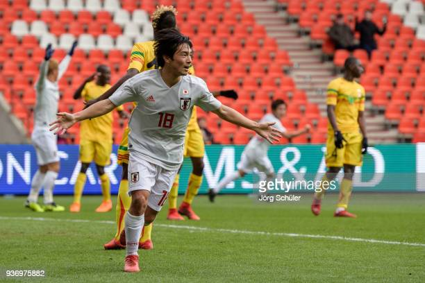 Shoya Nakajima of Japan reacts after his goal for the 11 during an international friendly between Japan and Mali at the Stade de Sclessin on March 23...