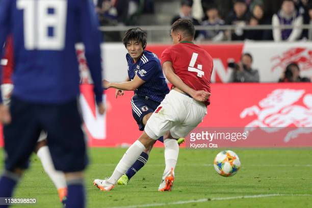 Shoya Nakajima of Japan scores the opening goal during the international friendly match between Japan and Bolivia at Noevir Stadium Kobe on March 26...