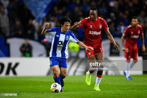 Shoya Nakajima of Porto is closed down Joseph Ayodele-Aribo of Rangers FC by during the UEFA Europa League group G match between FC Porto and Rangers...