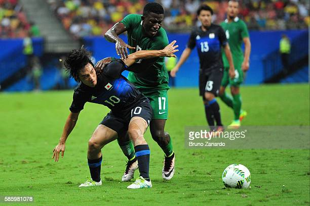 Shoya Nakajima player of Japan battles for the ball with Oluwafemi Ajayi player of Nigeria during 2016 Summer Olympics match between Japan and...