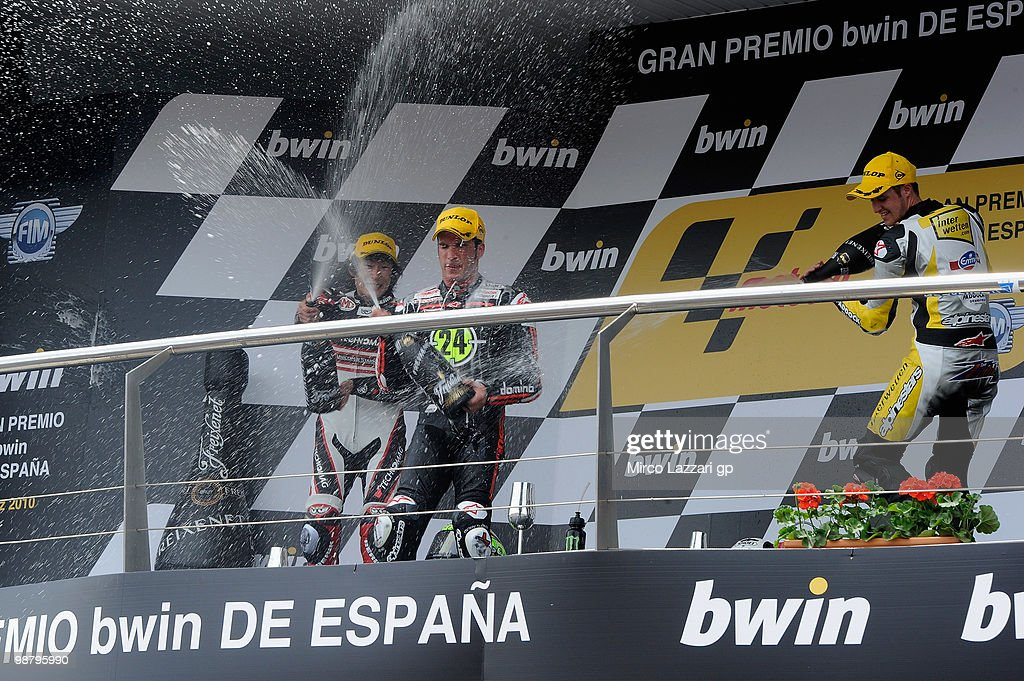 Shoya Tomizawa of Japan and Technomag - CIP and Thomas Luthi of Switzerland and Interwetten Moriwaki Racing and Toni Elias of Spain and Gresini Racing Moto2 celebrate and spray champagne on the podium at the end of the Moto2 race at Circuito de Jerez on May 2, 2010 in Jerez de la Frontera, Spain.
