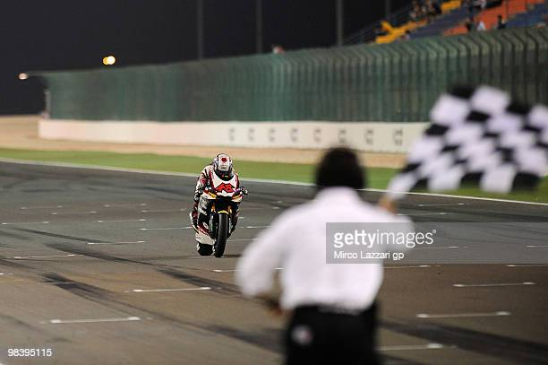 Shoya Tomizawa of Japan and Technomag - CIP cuts the finish line and celebrates the victory at the end of the Moto2 race of the Qatar Grand Prix at...