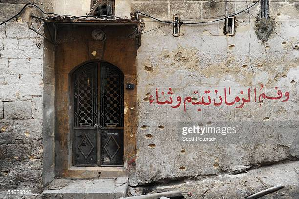 Shrapnel scars an ancient wall as Syrians come to terms with massive destruction from government air and artillery bombardment and a rising death...