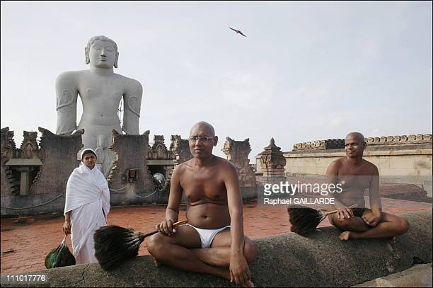 Shravana Belgola, Indragiri hill, Digambara monks and a nun in front of the statue of Bahubali - The ascetics' presence sanctifies the place in India...