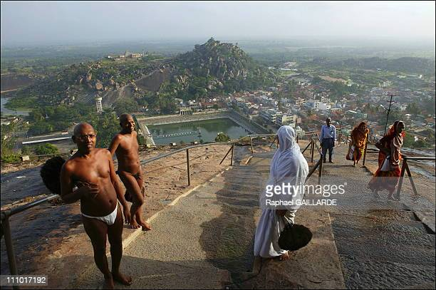 Shravana Belgola, Indragiri hill, Digambara monks and a nun walking up the stairs leading to the temples in India in November , 2004.