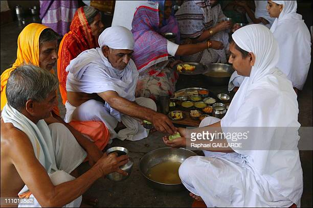 Shravana Belgola, meal of Digambara Jain nuns - They collect in their palms the food offered by devotees in India in November , 2004.