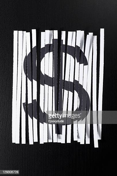 A shredded document with a dollar sign on it