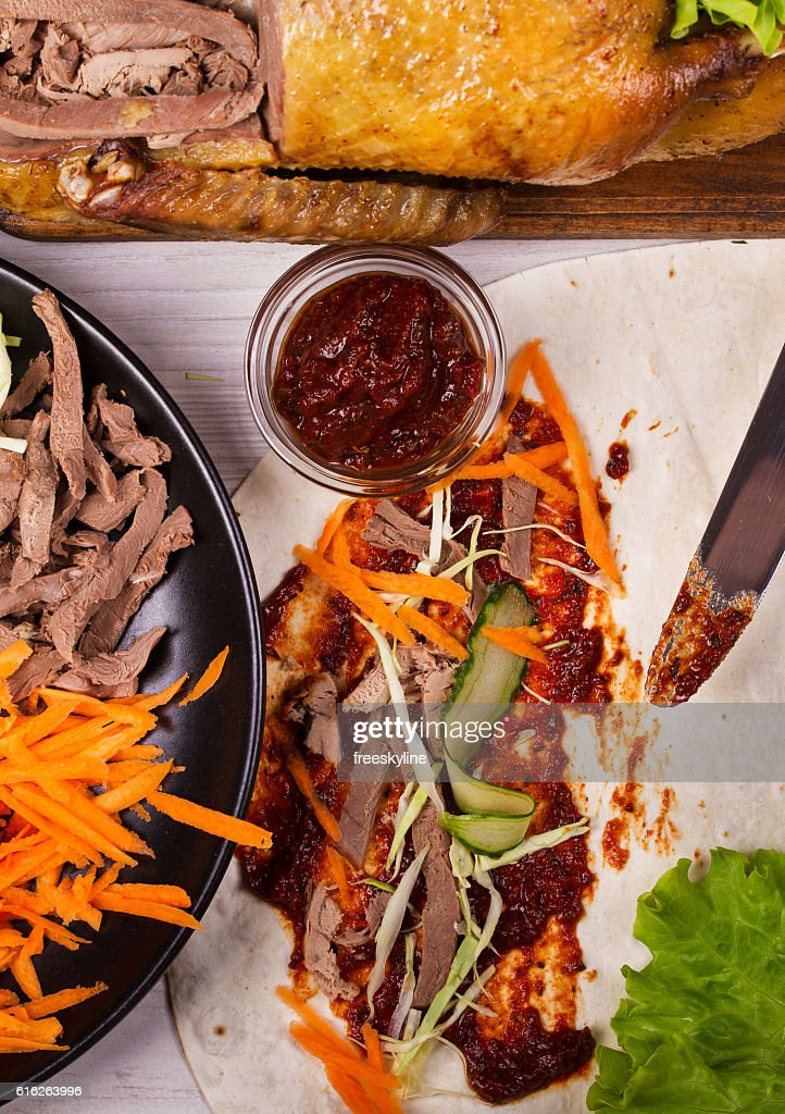 Shredded duck, carrot, cabbage, cucumber. Ingredients for rolls, wraps, burritos : Stock Photo