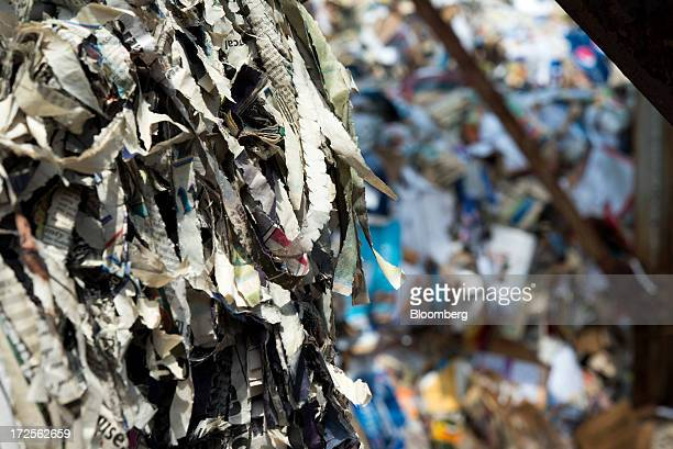 Shredded paper is bundled in the collection area before being made into new paper products at Newark Recycled Paperboard Solutions in Baltimore Ohio...