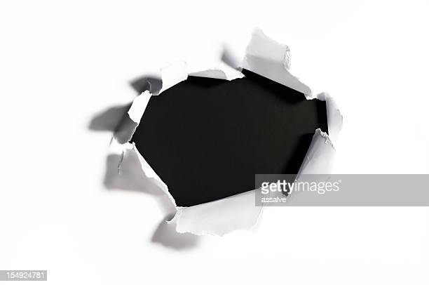shredded paper with a hole - hole stock photos and pictures