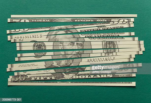 shredded us currency banknote, close-up - money laundering stock photos and pictures