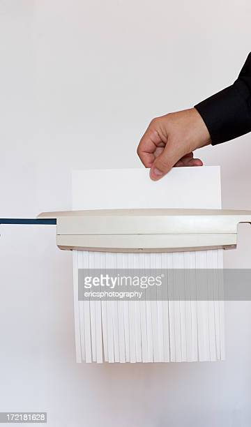 shredding a paper. - shredded stock pictures, royalty-free photos & images