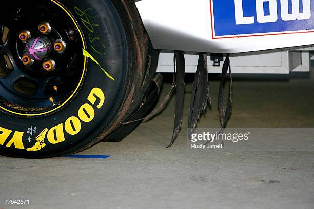 Shreds of the tire hang from the car of Jimmie Johnson driver of the Lowe's Chevrolet due to a burnout after winning the NASCAR Nextel Cup Series...