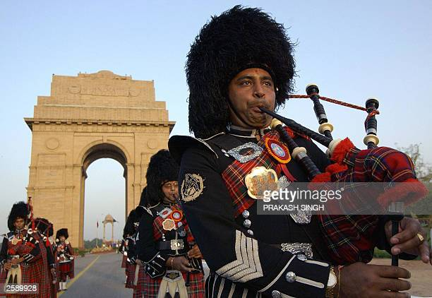 Shree Muktajeevan Pipe Band a London band comprised of English musicians of Indian origin play a salutation to WWII martyrs 01 October 2003 at India...