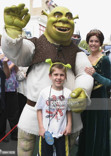 Shrek and Princess Fiona pose with Joshua Lacuone who turns seven today at the opening of the Shrek 4D Adventure at Warner Brothers Movie World...