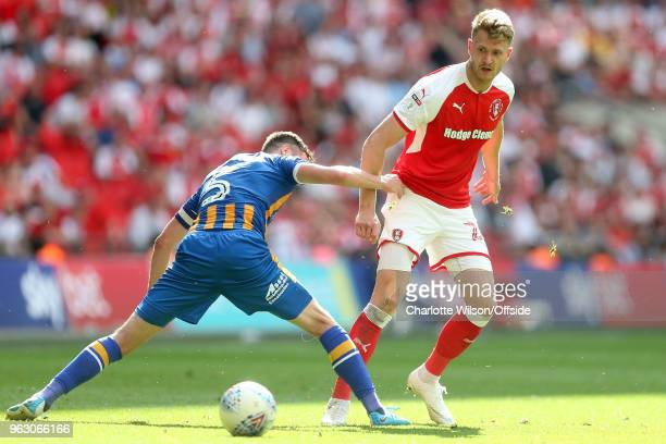 Shrewsbury captain Mat Sadler stretches to intercept Michael Smith of Rotherham during the Sky Bet League One Play Off Semi FinalSecond Leg between...