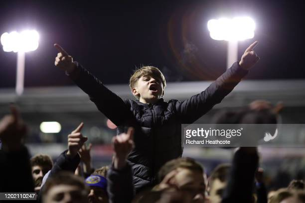 Shrewsbury fans celebrate on the pitch at the final whistle during the FA Cup Fourth Round match between Shrewsbury Town and Liverpool at New Meadow...