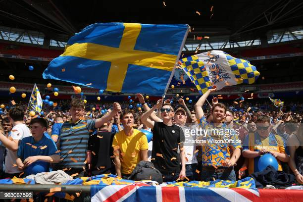 Shrewsbury fans wave flags and throw balloons and ticker tape during the Sky Bet League One Play Off Semi FinalSecond Leg between Rotherham United...