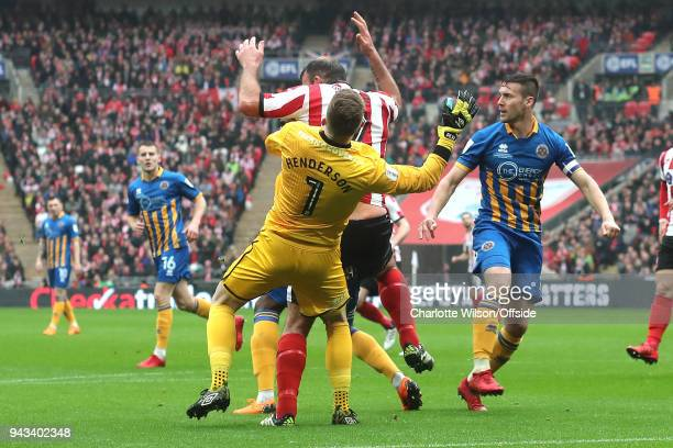 Shrewsbury goalkeeper Dean Henderson is knocked unconscious after colliding with Matt Rhead during the Checkatrade Trophy Final between Lincoln City...