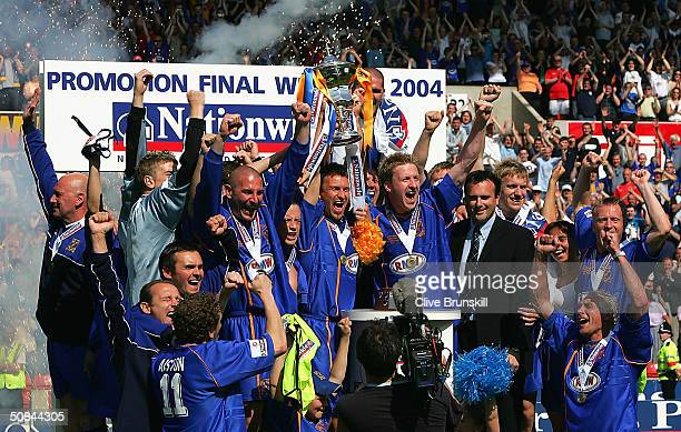 Shrewsbury Town celebrate as Captain Darren Tinson lifts the trophy after the Nationwide Promotional Final match between Aldershot Town and...