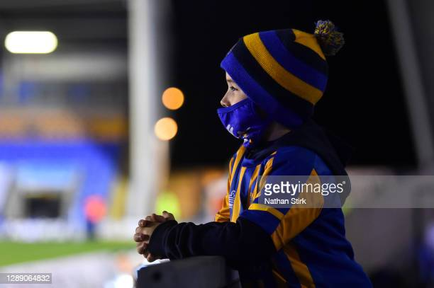 Shrewsbury Town fan looks on from inside of the stadium wearing a face mask ahead of the Sky Bet League One match between Shrewsbury Town and...