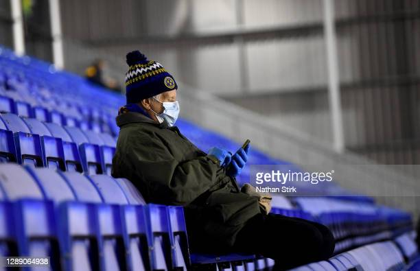 Shrewsbury Town fan looks on from their socially distanced seat whilst wearing a face mask ahead of the Sky Bet League One match between Shrewsbury...