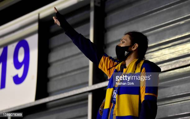 Shrewsbury Town fan wearing a mask shows her support during the Sky Bet League One match between Shrewsbury Town and Accrington Stanley at Montgomery...